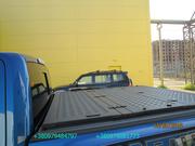 Трехсекционная крышка багажника для пикапа. Крышка кузова пикапа.